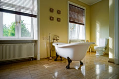 Renovated old-styled bathroom with beautiful retro bath Royalty Free Stock Photos