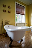 Renovated old-styled bathroom with beautiful retro bath Royalty Free Stock Photo