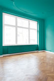Room with green walls and parquet floor royalty free stock image
