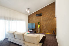 Renovated 70s architectural apartment with angeld roofline Stock Photography