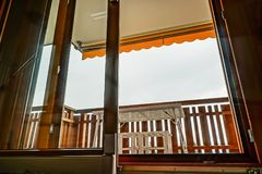 Renovated sliding door to the balcony. Comfort and ergonomic gla. Ss system. Laminated profile stock image
