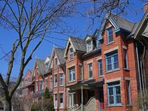 Victorian row houses with gables Stock Images