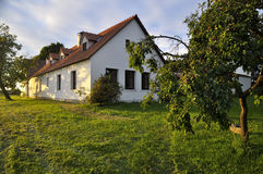 Renovated village homestead surrounded by fruit trees Stock Photos