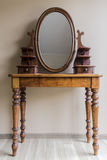 Renovated vintage dressing table. Made of wood with oval mirror stock photos