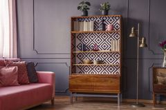 Free Renovated Wooden Bookcase With Geometrical Pattern And A Brass F Stock Photos - 124414373
