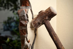Renovating house. Breaking wall with hammer for renovating house Royalty Free Stock Photos