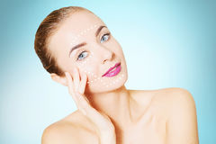 Renovating skin concpet. woman face portrait with lifting marks Royalty Free Stock Image