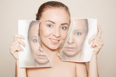 Renovating skin. Skin revitalising concept: woman with pure skin holding paper with empty space close to her face Stock Photo