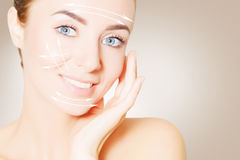 Renovating skin. woman face portrait with lifting marks. Renovating skin concpet. woman face portrait with lifting marks Stock Image