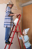 Renovation. Two girls and a ladder Royalty Free Stock Image