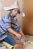 Renovation. Little girl wallpapering Royalty Free Stock Photo