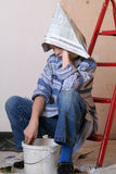 Renovation. Sad girl sitting on the ladder Stock Photography