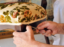 Renovation of an antique chair upholstery, upholsterer working Stock Photography