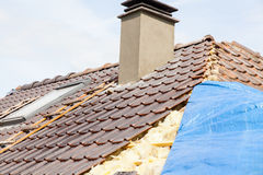 Renovation of a brick tiled roof Stock Images