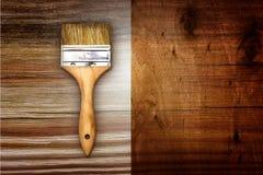 Renovation brush on wooden background Stock Image