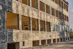 Renovation of the building. Thorough reconstruction of a brick building - demolition of construction royalty free stock image