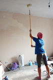 Renovation, ceiling, girl, painting Royalty Free Stock Image
