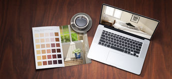 Renovation Computer Colour Design. A still life banner with a laptop computer, colour chart and cup of coffee on a wood background. Images on brochure and laptop Royalty Free Stock Image
