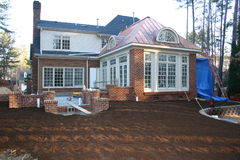 Renovation Exterior. Exterior of luxury home during renovation project royalty free stock photo