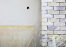Renovation at home decorate wall clinker brick tile glue Royalty Free Stock Photos