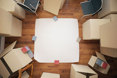 Renovation ideas concept. Stacks of cardboard boxes and blank poster on wooden floor. Top view. Renovation ideas concept. Mock up, 3D Rendering Stock Photos