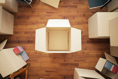 Renovation ideas concept. Stacks of cardboard boxes on wooden floor. Top view. Renovation ideas concept. Mock up, 3D Rendering Stock Photos