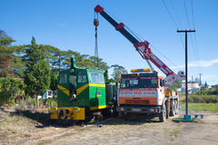 Renovation of the locomotive with the aid of the crane on the chassis of Russian Kamaz-64112 car at the railway station of Dalat c Royalty Free Stock Photography
