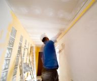 Renovation man blurred. A worker renovating home interior, motion blurred Royalty Free Stock Images
