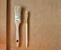 Renovation paint brush on wood. Table Stock Photo