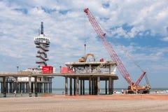Renovation Pier of Scheveningen through big red crane Stock Image