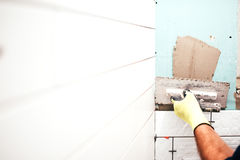 Renovation in progress, construction details, close up of worker hands using trowel Royalty Free Stock Photography