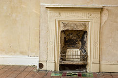 Renovation project. A cast iron fireplace in a Victorian house which requires renovation stock photography