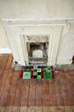 Renovation project. A fireplace and hearth in a Victorian house which requires renovation royalty free stock image