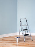 Renovation project. Ladder and a can of paint Stock Image