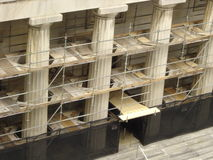 Renovation and Reconstruction. Scaffold around Columns of Century Old Building Stock Images