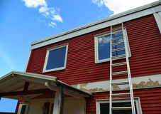 Renovation Of A Red Wooden House Facade Royalty Free Stock Image