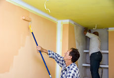 Renovation team painting room Stock Photo