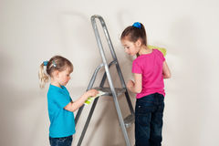 Renovation. Two girls choosing the color sample Royalty Free Stock Image