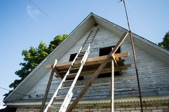 Renovation of a village house. With ladder, scaffolding and swallow nest Stock Images