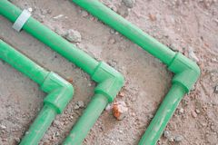 Renovation work,Bury a pvc pipe. Bury a pvc pipe in the wall,sanitary system installation royalty free stock photo
