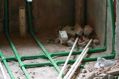 Renovation work,Bury a pvc pipe in the wall Royalty Free Stock Photo