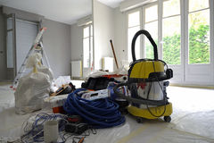 Renovations. Painting and electrical tools and floor protected by plastic Stock Images
