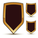 Renown  black shield shape emblems, 3d. Renown  black shield shape emblems with golden borders, 3d polygonal design elements, clear EPS 8 Royalty Free Stock Images