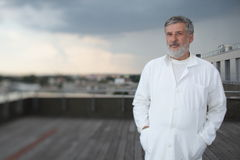 Renowned scientist/doctor. In a roof of research center/hospital Stock Photo