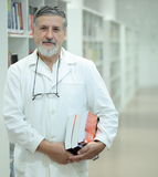 Renowned scientist/doctor in a library Royalty Free Stock Photos