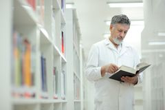 Renowned scientist/doctor in a library Stock Photo