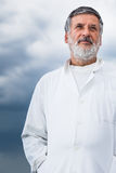 Renowned scientist/doctor standing on the roof Royalty Free Stock Images