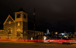 Renssaeler NY USA - town over looking Albany NY at night with Christmas lights on the street corner. Night scene with car trails. Royalty Free Stock Image