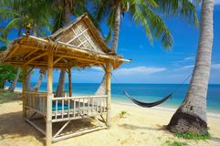 For rent. View of nice exotic bamboo hut on tropical beach stock image