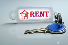 Rent. A key whit label isolated Royalty Free Stock Photos